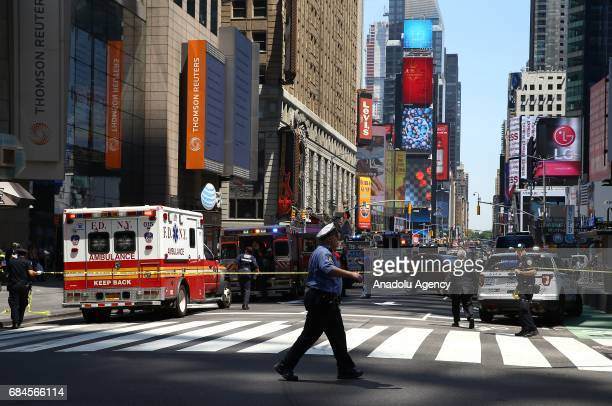 Ambulances arrive at the incident scene after it plowed into pedestrians on a busy sidewalk on the corner of West 45th St and Broadway at Times...