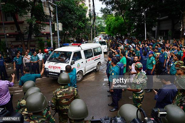 Ambulances believed to be carrying the bodies of some of the hostages that were killed in a bloody attack on an upscale restaurant in the Bangladeshi...