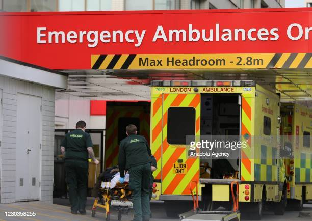 Ambulances bring emergency patients to St Thomas Hospital in London, England on December 30 2020. UK hospitals overwhelmed by the number of Covid-19...
