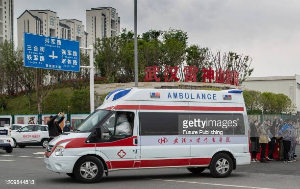 Ambulances carrying the last batch of patients leave leishenshan hospital and transfer to other hospitals, Wuhan City, Hubei Province, China, April...