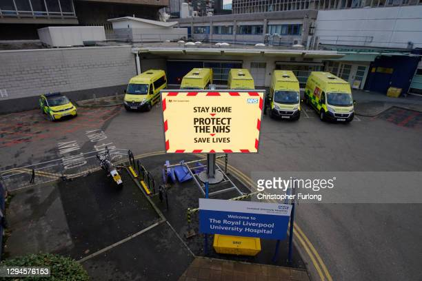 Ambulances line up as a electronic sign funded by the trust gives out coronavirus pandemic information to visitors and staff outside the Royal...