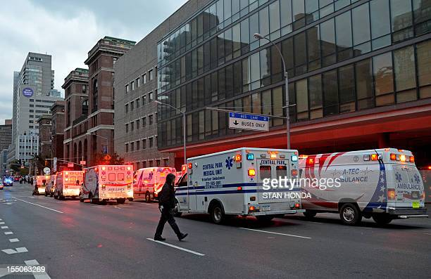 Ambulances line up outside Bellevue Hospital during a planned evacuation October 31 2012 in New York Bellevue Hospital the oldest in the country...
