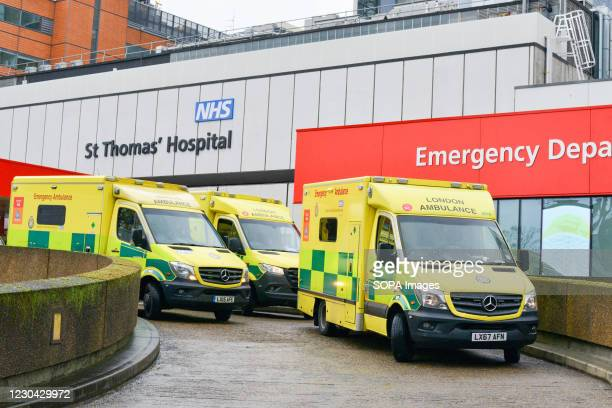 Ambulances park outside St Thomas Hospital in London.