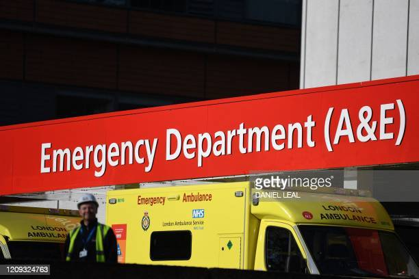 Ambulances park outside the entrance to the emergency department at St Thomas' hospital in central London where Britain's Prime Minister Boris...