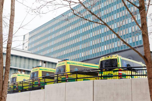 ambulances parked near hospital - ambulance hospital stock pictures, royalty-free photos & images
