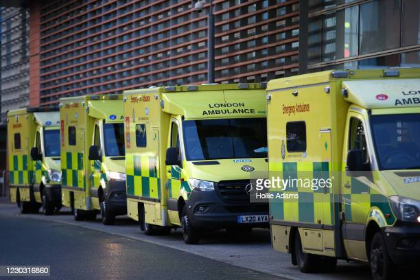 Ambulances parked outside The Royal London Hospital on December 27, 2020 in London, England. The hospital recently opened a new critical care unit,...