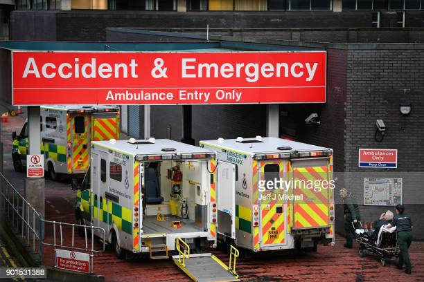 Ambulances sit at the accident and emergency at the Glasgow Royal hospital on January 5, 2018 in Glasgow, Scotland. Hospitals across the country are...