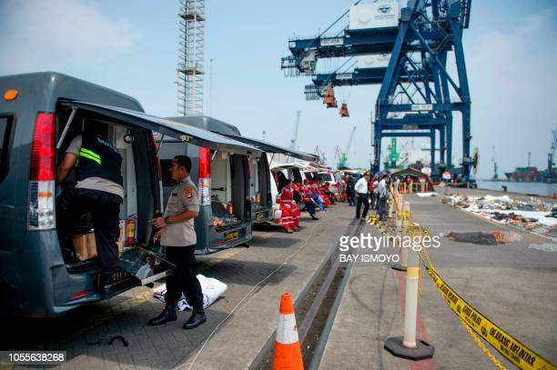Ambulances sit lined up to transfer recovered victims of the illfated Lion Air flight JT 610 at the Jakarta International Container Terminal in...