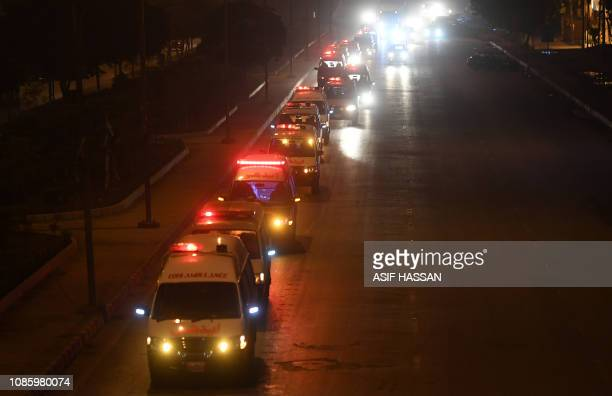 Ambulances transport the remains of bus passengers to an Edhi Foundation mortuary in Karachi on January 22 following a transport accident At least 24...