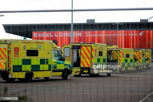 Ambulances wait in the car park at the ExCeL London exhibition centre in London on March 30 which has been transformed into a field hospital to be...