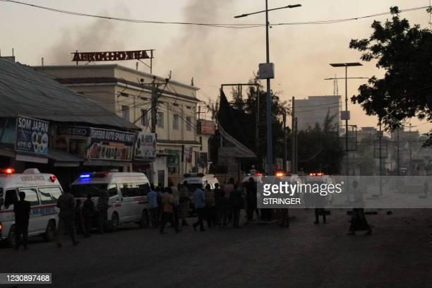Ambulances wait near the site where a bomb blasted in Mogadishu, Somalia, on January 31, 2021. - Armed men attacked a hotel in central Mogadishu...