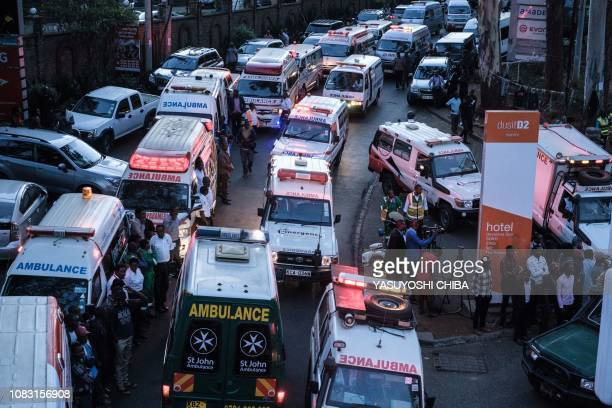 Ambulances wait on a road after a blast followed by a gun battle rocked a upmarket hotel complex in Nairobi on January 15 2019 At least five people...