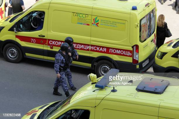 Ambulances with medical staff and security forces arrive at scene after an armed school attack carried out in Tatarstan's capital Kazan in Russia,...