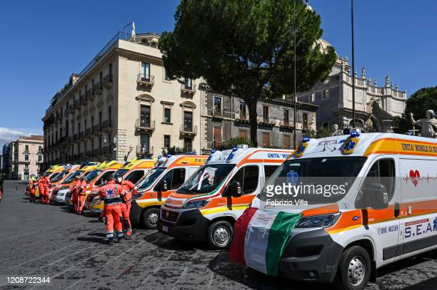 Ambulances with the volunteers in Piazza Duomo in front of the Town Hall wanted to be present during the minute of silence as a sign of condolence...
