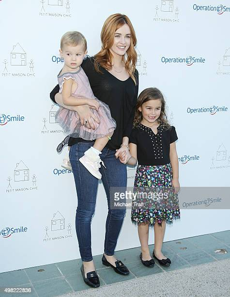 Ambyr Childers and her daughters arrive at the Petit Maison Chic and Operation Smile Kids charity fashion show held on November 21 2015 in Beverly...