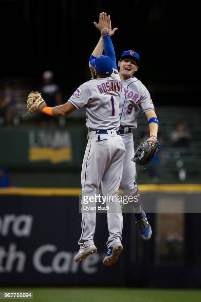 Amed Rosario and Brandon Nimmo of the New York Mets celebrate after beating the Milwaukee Brewers 50 at Miller Park on May 24 2018 in Milwaukee...