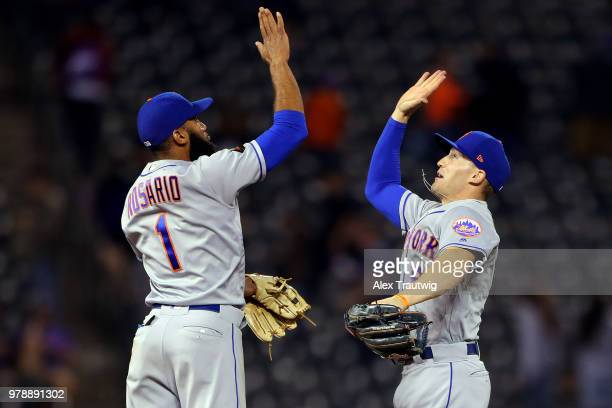 Amed Rosario and Brandon Nimmo of the New York Mets celebrate after defeating the Colorado Rockies 122 at Coors Field on Monday June 18 2018 in...