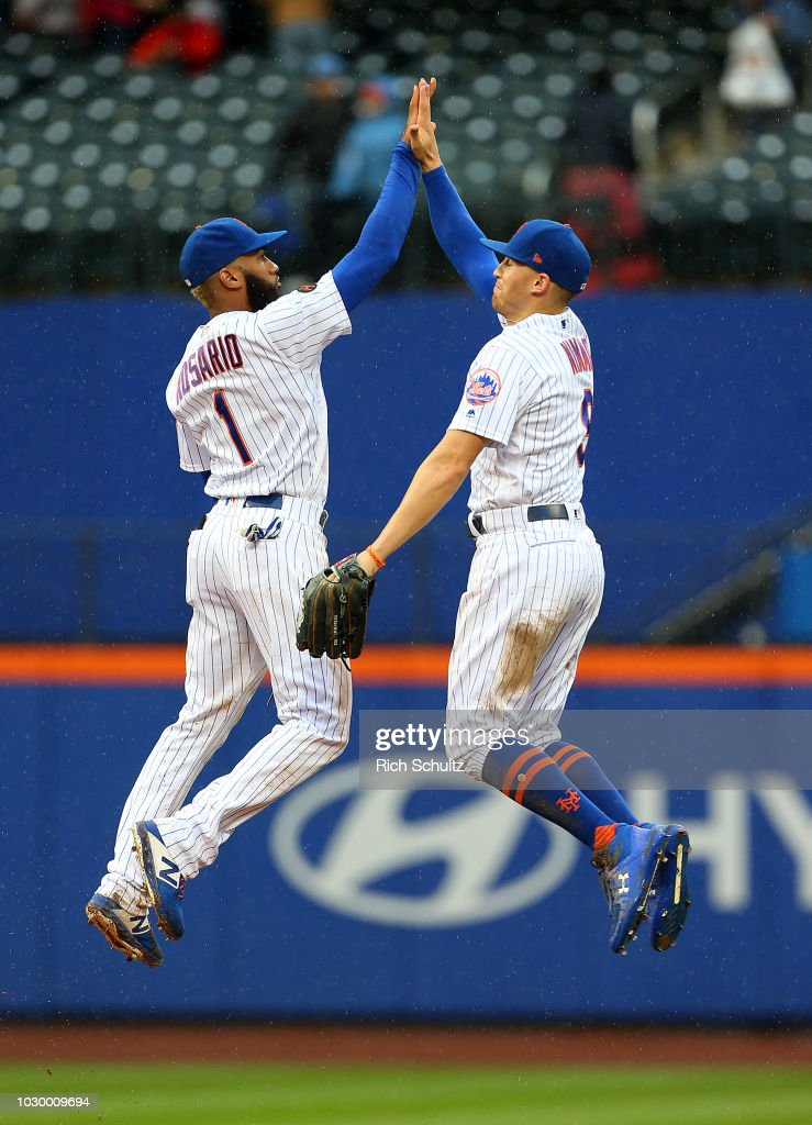 Amed Rosario #1 and Brandon Nimmo #9 of the New York Mets celebrate their 6-4 win over the Philadelphia Phillies during a game at Citi Field on September 9, 2018 in the Flushing neighborhood of the Queens borough of New York City.