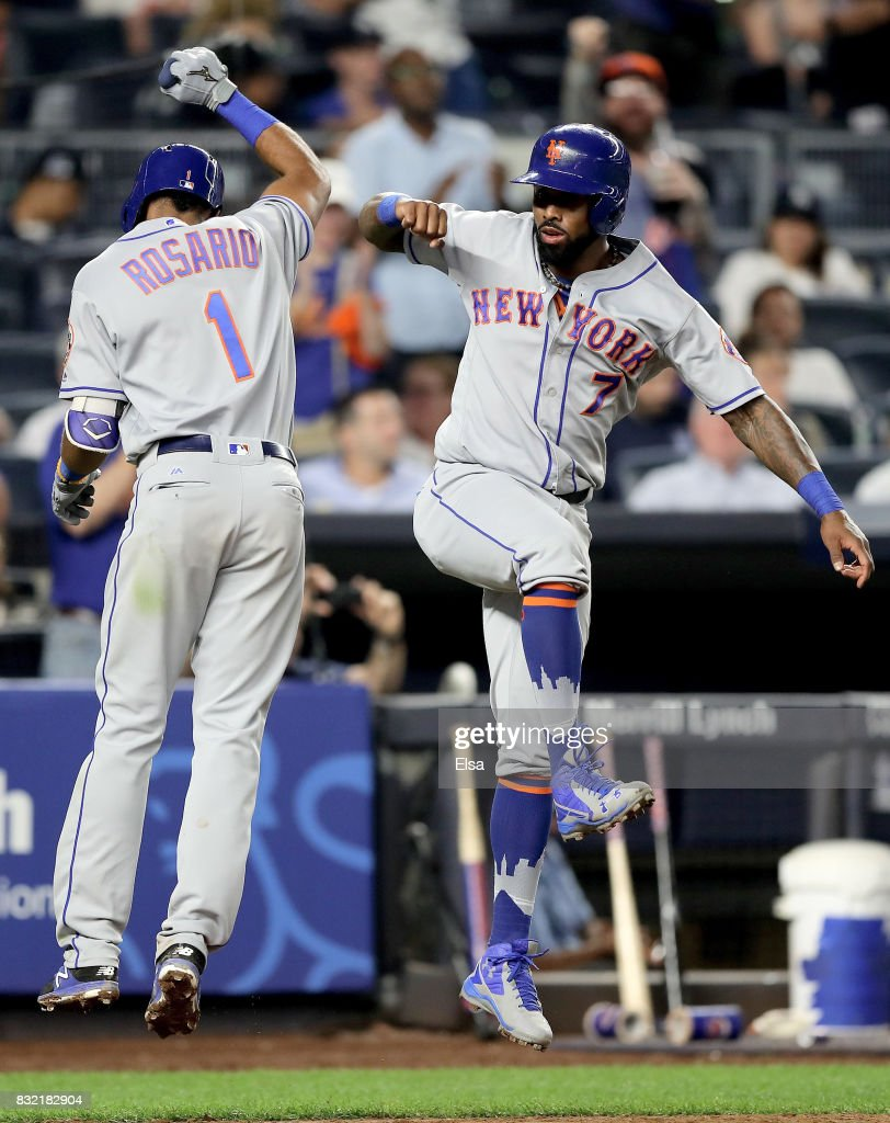 Amed Rosario #1 and Jose Reyes #7 of the New York Mets celebrate Rosario's two run home run in the ninth inning against the New York Yankees during interleague play on August 15, 2017 at Yankee Stadium in the Bronx borough of New York City.