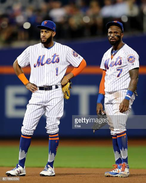 Amed Rosario and Jose Reyes of the New York Mets talks as Rougned Odor of the Texas Rangers is looked after by medical staff after Odor was hit by a...