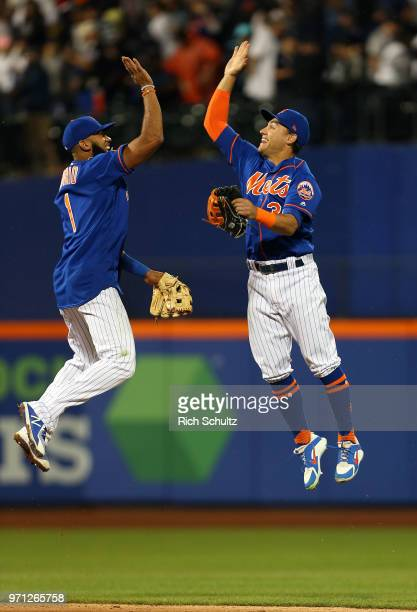 Amed Rosario and Michael Conforto of the New York Mets celebrate their 20 win over the New York Yankees during a game at Citi Field on June 10 2018...