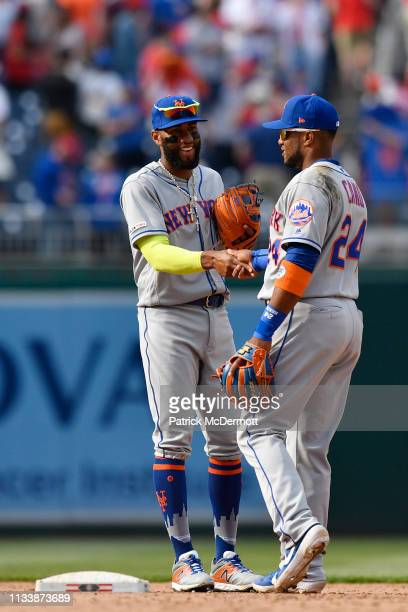 Amed Rosario and Robinson Cano of the New York Mets celebrate after the Mets defeated the Washington Nationals 118 at Nationals Park on March 30 2019...