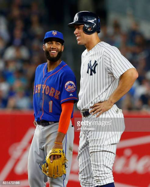 Amed Rosario of the New York Mets and Aaron Judge of the New York Yankees have a laugh during the fourth inning at Yankee Stadium on August 14 2017...