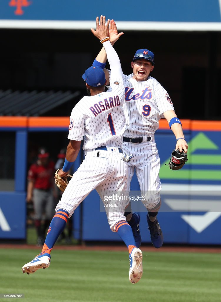 Amed Rosario #1 of the New York Mets and Brandon Nimmo #9 celebrate a 4-1 win against the Arizona Diamondbacks during their game at Citi Field on May 20, 2018 in New York City.