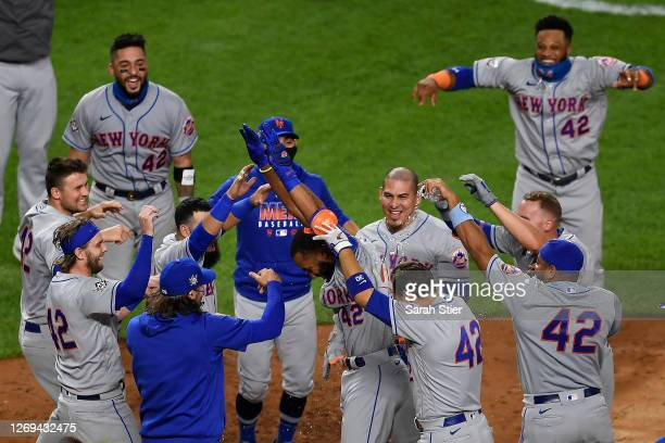 Amed Rosario of the New York Mets celebrates a walk-off home run during the seventh inning of the second game of a doubleheader against the New York...
