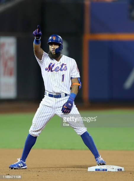 Amed Rosario of the New York Mets celebrates his double in the 10th inning against the Cleveland Indians at Citi Field on August 21 2019 in the...