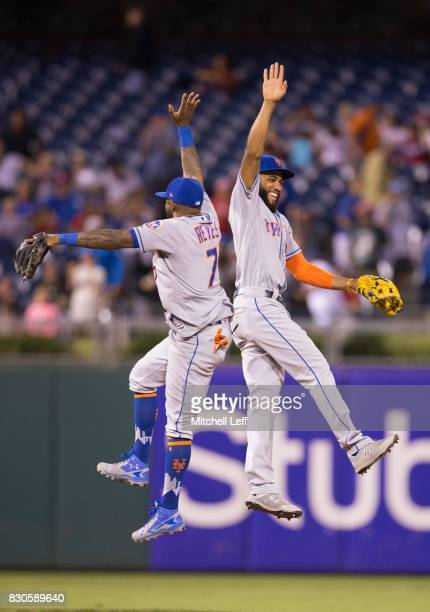 Amed Rosario of the New York Mets celebrates with Jose Reyes at the end of the game against the Philadelphia Phillies at Citizens Bank Park on August...