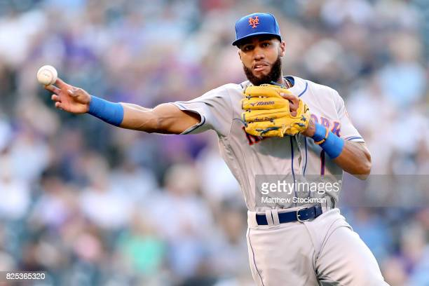 Amed Rosario of the New York Mets fields a ground ball hit by Mark Reynolds of the Colorado Rockies in the second inning at Coors Field on August 1...