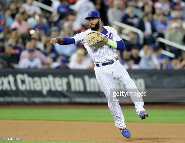 Amed Rosario of the New York Mets fields a hit by Andrew McCutchen of the San Francisco Giants in the eighth inning on August 20 2018 at Citi Field...