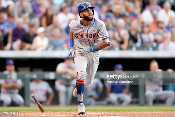 Amed Rosario of the New York Mets flies out in his first bat of his Major League debut in the second inning against the Colorado Rockies at Coors...