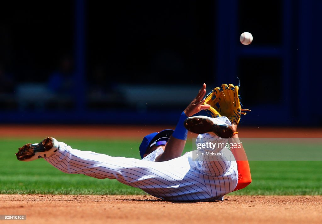 Amed Rosario #1 of the New York Mets flips the ball to second base for an out against the Texas Rangers during the second inning at Citi Field on August 9, 2017 in the Flushing neighborhood of the Queens borough of New York City.