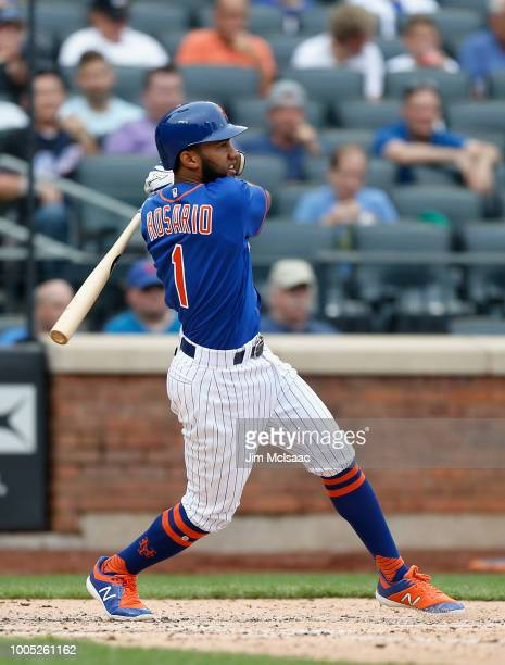 Amed Rosario of the New York Mets follows though on a fifth inning two run single against the San Diego Padres at Citi Field on July 25 2018 in the...