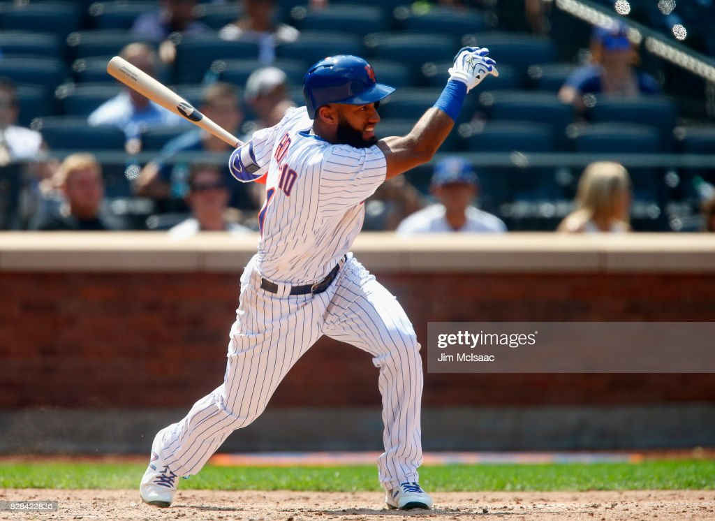 Amed Rosario #1 of the New York Mets follows through on an eighth inning base hit against the Texas Rangers at Citi Field on August 9, 2017 in the Flushing neighborhood of the Queens borough of New York City.