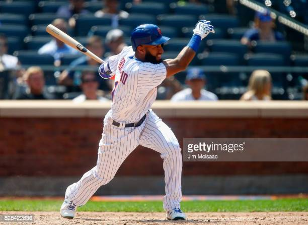 Amed Rosario of the New York Mets follows through on an eighth inning base hit against the Texas Rangers at Citi Field on August 9 2017 in the...