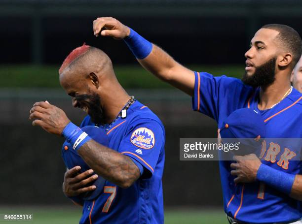 Amed Rosario of the New York Mets fools around with Jose Reyes of the New York Mets before the game against the Chicago Cubs on September 13 2017 at...