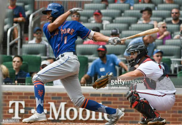 Amed Rosario of the New York Mets hits a ground ball to second base to allow Jose Reyes to score against the Atlanta Braves in the first inning at...