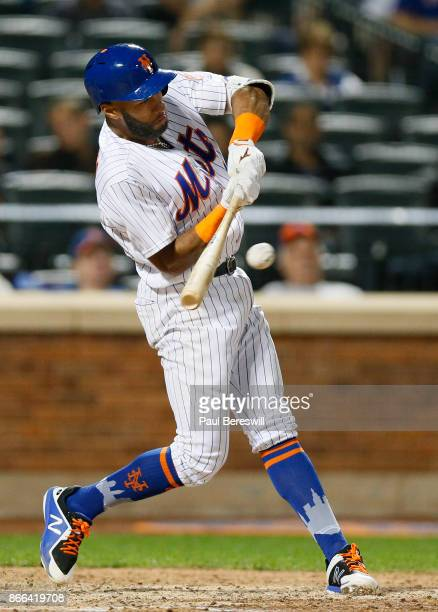 Amed Rosario of the New York Mets hits a single in the 8th inning of an MLB baseball game against the Washington Nationals on September 22 2017 at...