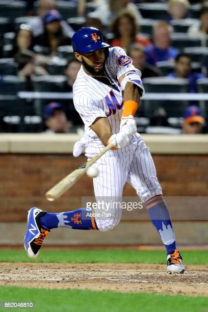 Amed Rosario of the New York Mets hits a single in the eighth inning against the Washington Nationals on September 22 2017 at Citi Field in the...