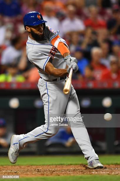 Amed Rosario of the New York Mets hits a single in the sixth inning against the Cincinnati Reds at Great American Ball Park on August 29 2017 in...