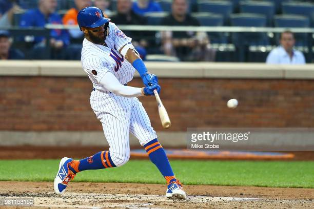 Amed Rosario of the New York Mets hits a single to center field in the third inning against the Miami Marlins at Citi Field on May 21 2018 in the...