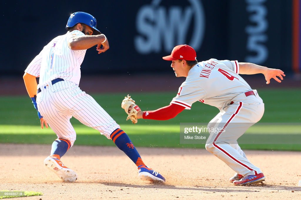 Amed Rosario #1 of the New York Mets is tagged out on a fielder's choice by Scott Kingery #4 of the Philadelphia Phillies during Game One of a doubleheader at Citi Field on July 9, 2018 in the Flushing neighborhood of the Queens borough of New York City.