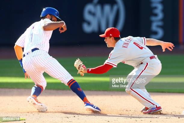 Amed Rosario of the New York Mets is tagged out on a fielder's choice by Scott Kingery of the Philadelphia Phillies during Game One of a doubleheader...