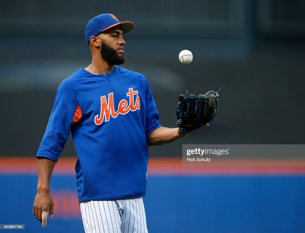 Amed Rosario #1 of the New York Mets juggles a ball as he wears a splint on his right index finger during infield practice before a game against the Cincinnati Reds at Citi Field on September 7, 2017 in the Flushing neighborhood of the Queens borough of New York City.