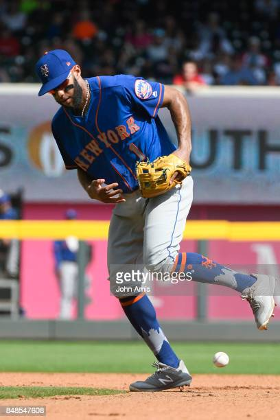 Amed Rosario of the New York Mets looses his grip for a fielding error on a ball hit bu Johan Camargo of the Atlanta Braves in the seventh inning at...