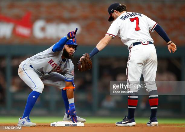Amed Rosario of the New York Mets reacts after coming up with a double in the fifth inning of an MLB game against the Atlanta Braves at SunTrust Park...