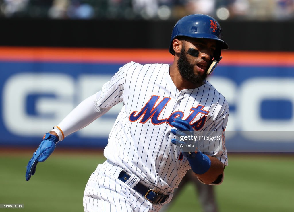 Amed Rosario #1 of the New York Mets rounds the bases after hitting a home run against Jorge De La Rosa #29 of the Arizona Diamondbacks in the seventh inning during their game at Citi Field on May 20, 2018 in New York City.